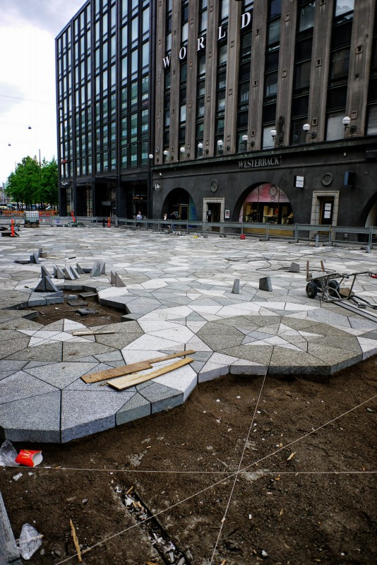 Complex paving going down. A grace note in an interesting city.